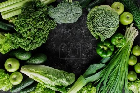 top view of green vegetables on dark concrete table, healthy eating concept