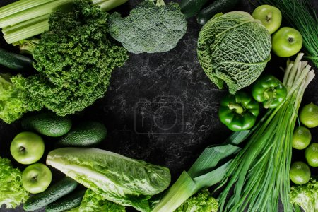 Photo for Top view of green vegetables on dark concrete table, healthy eating concept - Royalty Free Image