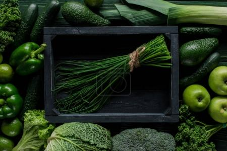 Photo for Top view of chives in wooden box between green vegetables, healthy eating concept - Royalty Free Image