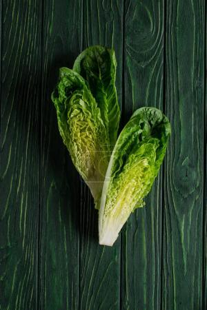 top view of cut green cabbage on wooden table, healthy eating concept