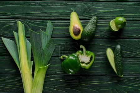 Photo for Top view of cut green avocado, cucumber and lime on table, healthy eating concept - Royalty Free Image