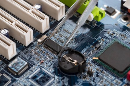 Photo for Fixing standard motherboard with microchips and schemes - Royalty Free Image