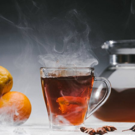 Photo for Steaming cup of spicy black tea with lemon - Royalty Free Image