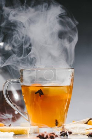 Photo for Glass cup of hot steaming tea - Royalty Free Image
