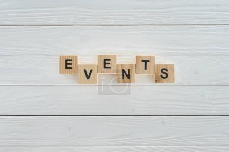 Photo for Top view of events word made of wooden blocks on white wooden surface - Royalty Free Image