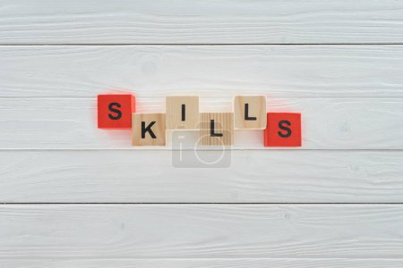 Photo for Top view of skills inscription made of blocks on white wooden surface - Royalty Free Image