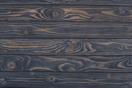 top view of dark grunge wooden background