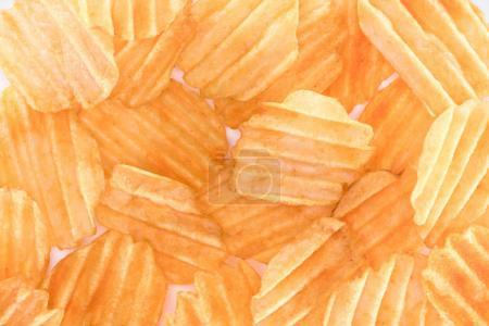 Photo for Full frame view of crispy unhealthy potato chips background on white - Royalty Free Image