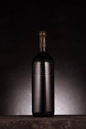 Photo for Single bottle of luxury red wine on black - Royalty Free Image