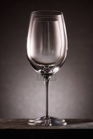 two empty wineglasses in row on black