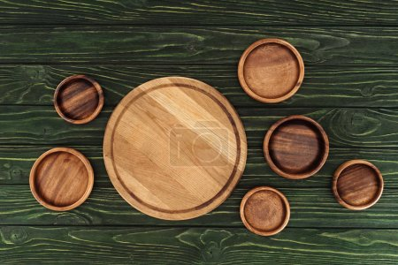 different types of wooden round cutting boards on table