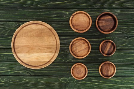 various types of wooden round cutting boards on table