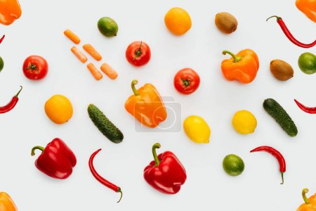 top view of collection of colored fruits and vegetables isolated on white