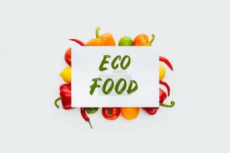 Photo for Top view of sheet of paper with text Eco Food on vegetables and fruits isolated on white - Royalty Free Image