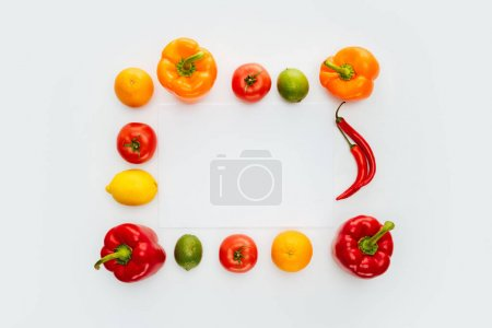top view of frame of vegetables and fruits isolated on white