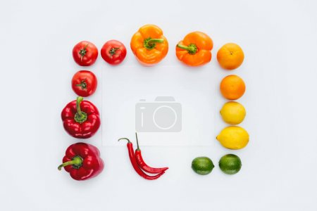 top view of frame of colored yummy vegetables and fruits isolated on white
