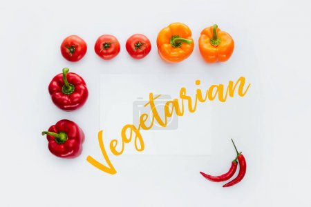 top view of frame of vegetables with text Vegetarian isolated on white