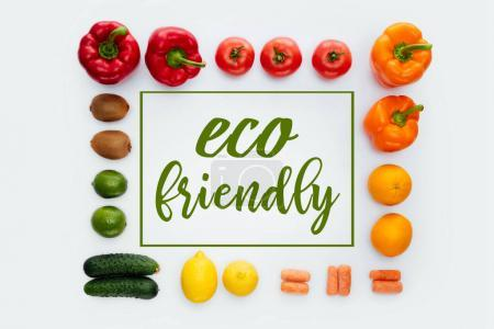 top view of frame with vegetables and fruits and text Eco Friendly isolated on white