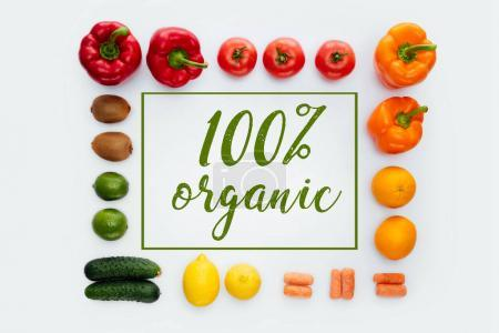 top view of frame with vegetables and fruits and text 100% Organic isolated on white