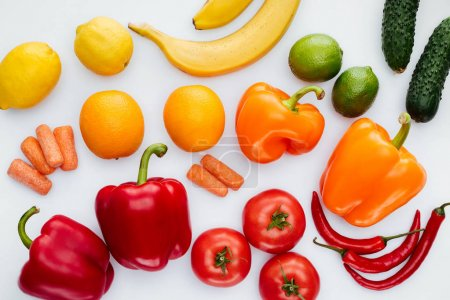 Photo for Top view of colored ripe vegetables and fruits isolated on white - Royalty Free Image