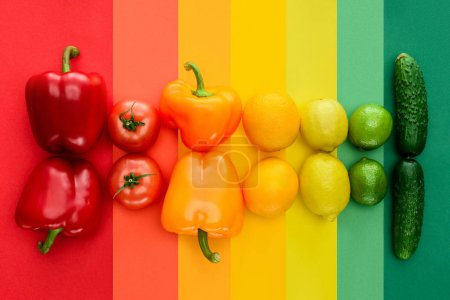 Photo for Top view of ripe fruits and vegetables on rainbow surface - Royalty Free Image