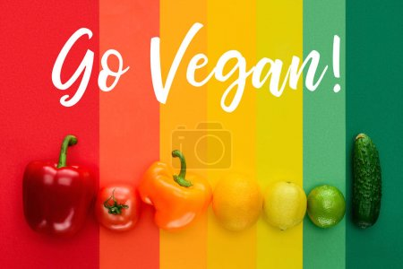 Photo for Top view of ripe fruits and vegetables with words Go Vegan on colored surface - Royalty Free Image