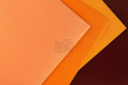 Photo for Top view of arranged colorful sheets of paper backdrop - Royalty Free Image