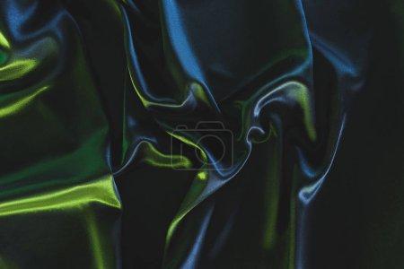 full frame of dark elegant silk fabric as background