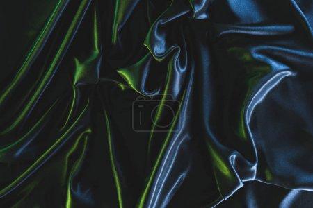 Photo pour Plein cadre de tissu de soie élégant foncé comme fond - image libre de droit
