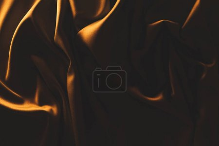 close up view of dark crumpled silk cloth as backdrop