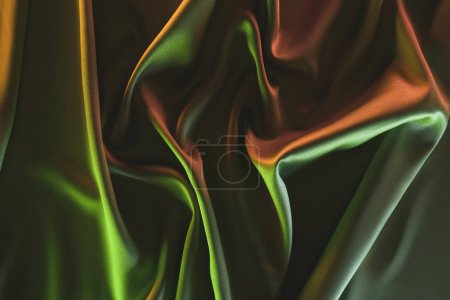 toned picture of elegant folded green silk fabric background