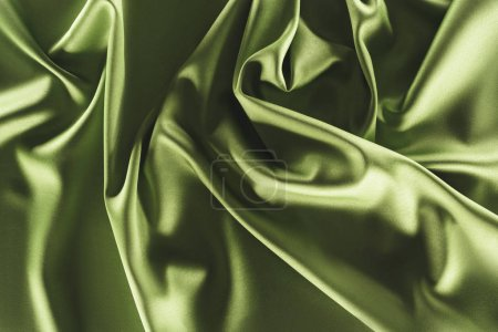 Photo for Close up view of elegant green silk cloth as backdrop - Royalty Free Image