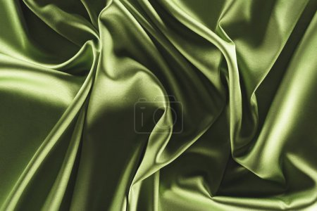 close up view of elegant green silk cloth as backdrop