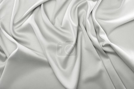 close up view of folded grey silk fabric as backdrop