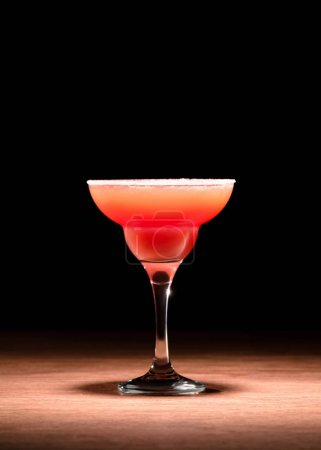 red alcohol drink on wooden surface