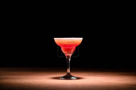 Photo for Red alcohol cocktail on wooden table - Royalty Free Image