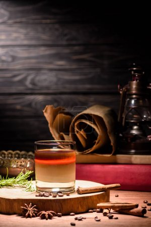 alcohol drink with coffee on wooden board, coffee beans on table