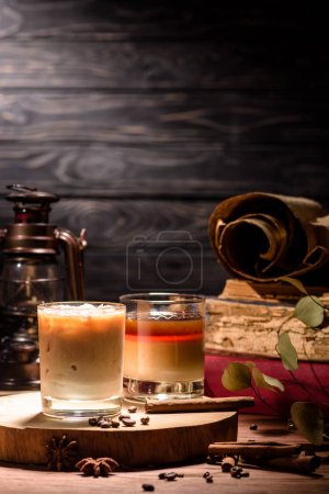 tasty alcohol white russian drinks with coffee on wooden board on table