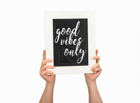 Photo for Cropped view of woman holding chalkboard with inscription good vibes only isolated on white - Royalty Free Image