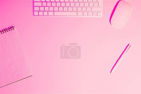 Photo for Top view of computer keyboard and mouse, empty textbook and pen on pink table - Royalty Free Image