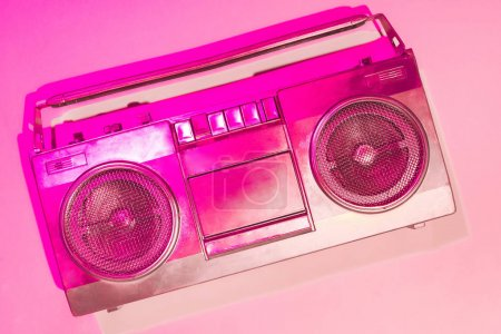 pink toned picture of retro boombox on pink background