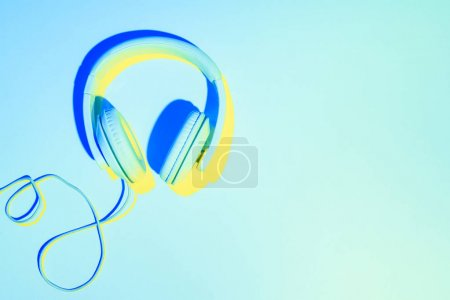blue toned picture of headphones on blue background