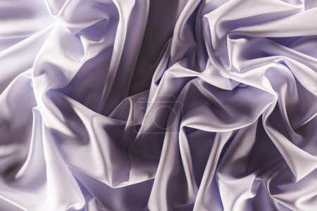 Photo for Full frame of folded elegant purple silk fabric as background - Royalty Free Image