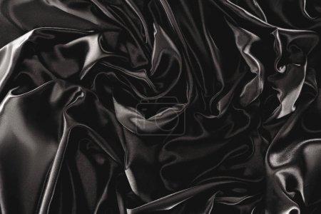 full frame of black elegant silk cloth as background