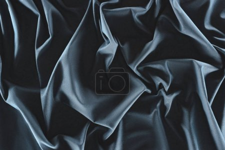 Photo for Close up view of crumpled dark blue silk fabric as background - Royalty Free Image