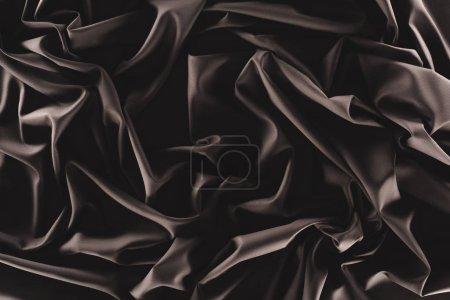 plein cadre de tissu de soie noire pliée comme toile de fond
