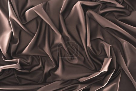 Photo for Full frame of folded dark silk cloth as background - Royalty Free Image