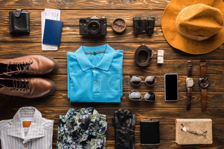 Photo for Top view of traveller stuff kit on rustic wooden surface - Royalty Free Image