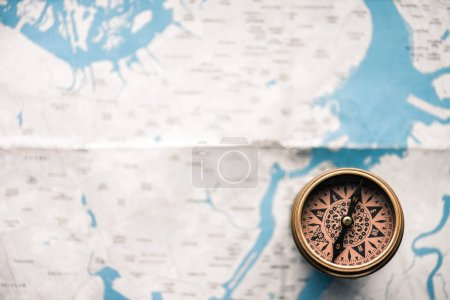 Photo for Top view of vintage compass on map - Royalty Free Image