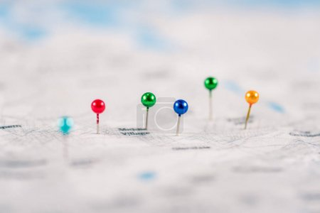 close-up shot of colorful pins on map